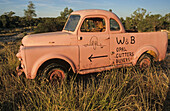 advertising sign, car wreck Lightning Ridge,NSW, Australia