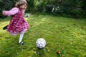Girl playing soccer, Bavaria, Germany