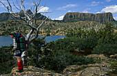 Female backpacker at Lake Elysia in the Labyrinth,  Lake Elysia, Labyrinth, Mount Geryon, walls of the Acropolis, Overland Track, Cradle Mountain-Lake St Clair National Park, Tasmania, Australia