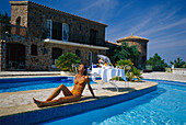 Woman sunbathing at the pool, Cote d´Azur, France, Europe