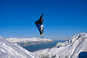 Snowboarder in action, Performing a jump, Innsbruck, Tyrol, Austria