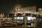 Procession on the ponton bridge concerning Santa Maria della Salute on November 21st, festa della Salute, Venice, Italy