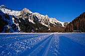 Frozen Lake of Antholz with Cross-country ski run in the snow, Antholz, Val Pusteria, South Tyrol, Italy