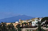 View at houses in front of the volcano Etna, Taormina, Sicily, Italy, Europe