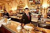 Waiter at the counter of Cafe Piatti, Torino, Piedmont, Italy, Europe