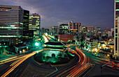 Traffic at night, highrise buildings, Seoul, South Korea