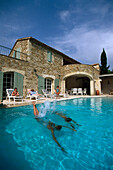 Young people jumping into pool, Uzes, Provence, France
