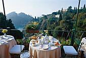 Tables are laid at the terrace of Hotel Splendido, Portofino, Liguria, Italy, Europe