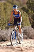 Woman on a mountainbike tour, Gooseberry Trail, Zion National Park, Springdale, Utah, USA