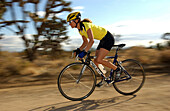 Woman on a racing bike in Joshua Tree National Park, California, USA