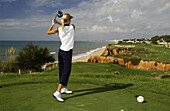 Woman playing golf at Vale do Lobo, Portugal