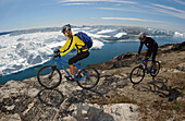 A couple on a mountainbike tour, Ilulissat, Greenland