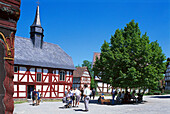 People and old half timbered houses in the sunlight, Open Air Museum Hessenpark, Taunus, Hesse, Germany, Europe