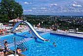 People at open air pool Opelbad, Neroberg, view over Wiesbaden, Hesse, Germany, Europe