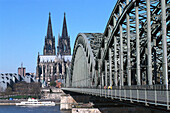 Cologne Cathedral and Hohenzollern bridge in the sunlight, Cologne, North Rhine-Westphalia, Germany, Europe