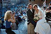 Bridal couple posing for the photographer, Rome, Latium, Italy, Europe