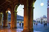 View through arcade at Piazza San Marco in the evening, Venice, Veneto, Italy, Europe