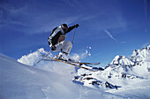 Skier jumping during downhill, Stubai, Austria