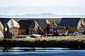 People on swimming Uro reed island, Puno, Lake Titicaca, Peru, South America, America