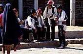 Knitting laughing men, Isla Taquile, Lake Titicaca, Peru, South America, America