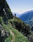 Hiker enjoying panorama, Aletsch Glacier, Bernese Oberland, Switzerland