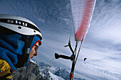 Paragliding Pilot in flight, Sella, Dolomites, South Tyrol, Italy
