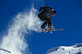 Snowboarder in action, Performing a jump, Zugspitze Bavaria, Germany