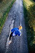 Jogger on country road, Stubaital Valley, Tyrol, Austria