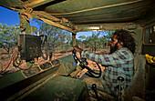 Aboriginal stockmen driving a car, catching wild bulls, Gibb River Station, Kimberley, Western Australia, Australia