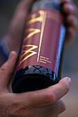 Australian red wine bottle in hand, Wandin Valley Vineyard, Asutralia