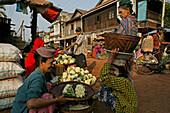 woman selling produce, Market day in Bago, Myanmar