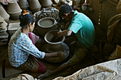 Potter makes water containers, potter wheel, Drehscheibe, Toepferei Werkstatt, small family pottery business, hard manual labour, water vessels