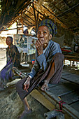 elderly woman smokes cigar, Burma, Myanmar