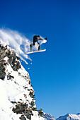 Snowboarding, Sprung ueber Felsen