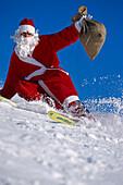 Santa Claus skiing downhill