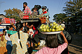 Women selling fruit at country bus station, Myanmar