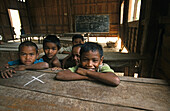 young boys in village school in Boloven Plateau, Laos