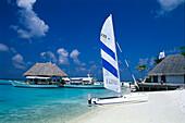 Catamaran on the beach under blue sky, Four Seasons Resort, Kuda Hurra, Maledives, Indian Ocean