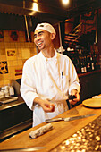 Laughing cook at the restaurant Oba Chine, Beverly Hills, Los Angeles, Kalifornien, USA