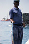 Fisherman presents his catch at the port of Punta do Sol, Santo, Antáo, Cape Verde