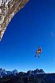 Free climber rappelling, Cinque Torri, Dolomites, Province of Belluno, Veneto, Italy
