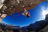 Man freeclimbing at rock formation, Cinque Torri, Dolomites, Province of Belluno, Veneto, Italy