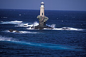 Lighthouse on little island, near Chora, Andros, Cyclades, South Aegean, Greece