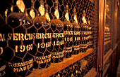 A row of wine bottles standing on a shelf, Funchal, Madeira, Portugal