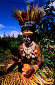 Girl with painted face in preparation for a festival, Sing sing ceremony, Huli, Mt Hagen, Eastern Highlands, Papua New Guinea, Melanesia