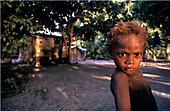 Native boy looking sternly at the camera, Rabaul, Melanesia, Papua, New Guinea
