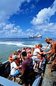 Tourist, Landing, Takapotu, Tuamotu Islands French Polynesia, South Pacific