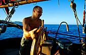 Sailor at Helm, Sailing Vessel, Bora Bora French Polynesia, South Pacific