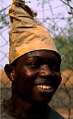 Funny Portrait, African worker wearing a hat, smiling, Goma, Congo, Africa