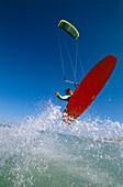 Man kiteboarding, jump